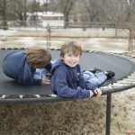 Two Boys Playing on Trampoline